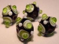 Glasperlen Rund mit Augen 11mm Black Olivine