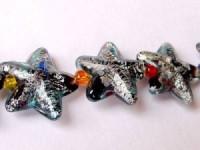 Glasperlen silverfoiled Stern 22x22mm schwarz bunt