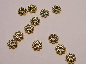 Spacer in Blütenform goldfarben 4mm 50 Stück